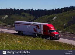 A Red Semi-Truck Pulls A White
