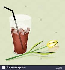 Coffee Time A Glass Of Iced Or Cola With Beautiful Yellow Tulip Served As Beverage Cream Milk On Retro Blue