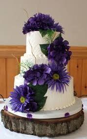 3 Tier Textured Buttercream Wedding Cake Decorated With Purple Silk Hydrangeas And Sunflowers