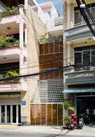 100 Townhouse Facades White Grid Inserted Into Vietnamese Townhouse By Block