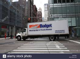 A Budget Moving Truck Making A Right Turn At An Intersection On ... Box Moving Truck Rental Services Chenal 10 Seattle Pickup Airport Pick Up Wa Cheap Cheapest Rental Truck Company Brand Coupons Trucks With Unlimited Mileage Luxury Franklin Rentals For A Range Of Trucks Near Me U0026 Van Penske Charlotte Nc Budget South Blvd Beleneinfo Companies Comparison Promo Codes Jill Cote Sale Genuine Which Moving Size Is The Right One You Thrifty Blog
