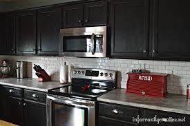 White Subway Tile Backsplash with Black Cabinets