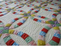 Close up Double Wedding Ring quilt quilting design by Kim Brunner