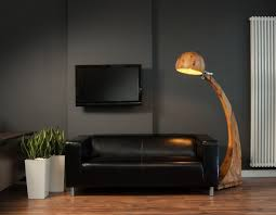Living Room Decorating Ideas Black Leather Sofa by Black Accents Wall Paint Of Modern Living Room Idea With Black