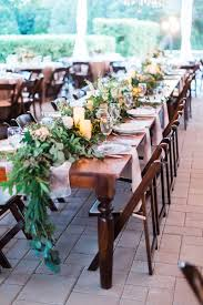 Head Table Of Foliage Garland Candles And Floral Accents