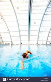 100 Kd Pool Man Swimming In An Indoor Swimming Pool Professional Swimmer Stock
