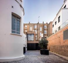 100 Belsize Architects Pivoting Louvres Conceal Windows Set Into Brick Facade Of