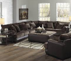 Furniture Furnishing Rustic Style Of Wooden Laminate Flooring Idea With Dark Brown Sofa Using Cushions