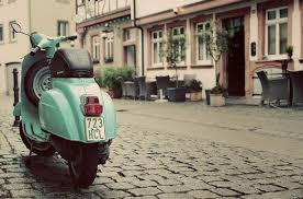 Parked Green Vespa At Bavaria Germany