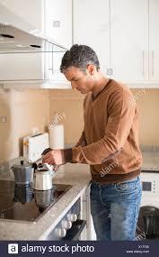Man Making Coffee In Kitchen
