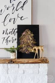 Today Im Sharing Not One But Two DIY Gold Foiled Brush Strokes Holiday Projects These Metallics On Black Gift Tags And Christmas Tree Sign Are Modern