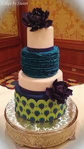 Peacock Themed Wedding Cake With Purple Sugar Peonies