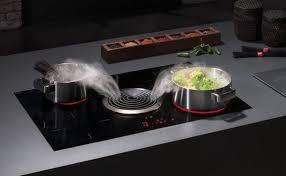 cuisiner avec l induction plaques à induction avec hotte intégrée guide d achat plaque à
