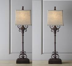 SET Of TWO TUSCAN BUFFET LAMPS A Distressed Rust Brown Finish With Black Undertones Gives This Metal Lamp Rustic Appeal Topped An Off White Linen