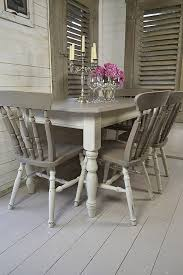 grey white shabby chic dining table with 4 chairs artwork
