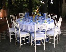 With The Wedding Program On Top Of Round Battenburg Lace Placemats Blue Tables