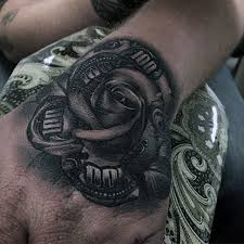 Shaded Black And White Ink Money Rose Tattoo On Gentleman