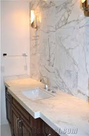 traditional bathroom featuring white marble vanity and calacatta