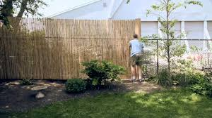 Installing A Bamboo Friendly Fence On A Chain Link Fence ... Building A Backyard Fence Photo On Breathtaking Fencing Cost Patio Ideas Cheap Deck Kits With Cute Concepts Costs Horizontal Pergola Mesmerizing Easy For Dogs Interior Temporary My Bichon Outdoor Decorations Backyard Fence Ideas Cheap Nature Formalbeauteous Walls Wall Decorative Enclosing Our Pool Made From Garden Privacy Roof Futons Installation