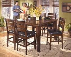Larchmont Burnished Dark Brown 7 Pc Dining Room Counter Butterfly Extension Table 6 Upholstered