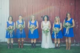 Bride Wearing A Line Gown And 5 Bridesmaids Blue Summery Dresses Cowboy Boots
