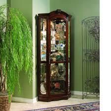 corner curio cabinet in medallion cherry by pulaski home gallery