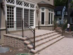 Safety First: Install An Outdoor Stair Railing | Concrete Anchors ... Metal And Wood Modern Railings The Nancy Album Modern Home Depot Stair Railing Image Of Best Wood Ideas Outdoor Front House Design 2017 Including Exterior Railings By Larizza Custom Interior Wrought Iron Railing Manos A La Obra Garantia Outdoor Steps Improvements Repairs Porch Steps Cable Rail At Concrete Contemporary Outstanding Backyard Decoration Using Light 25 Systems Ideas On Pinterest Deck Austin Iron Traditional For