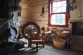Interior Of An Old Country House With Antique Spinning Wheel Stock Photo