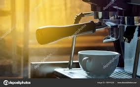 Making Coffee In The Machine Morning Atmospheric Lightin Stock Photo