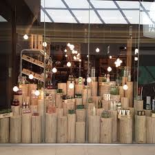 Wonderful Shop Or Store Display Idea Using White Washed Peeled Pale Wood Stumps For