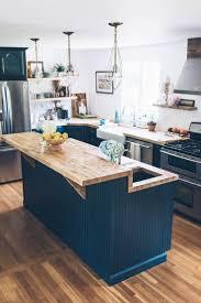 blue kitchen cabinet white glass tile backsplash granite
