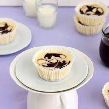 Indulge a little with these bite size blueberry swirl cheesecakes