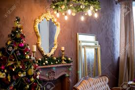 Christmas Tree Mirror Chandelier Interior In Purple And Gold Colors Stock Photo