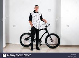 Teenager Posing With A Vintage Style Retro Clothing And Bike