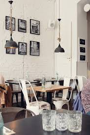This Cafe Looks Like It Has A Modern Look With Vintage Feel The Looking Interior Helps Bring To Carol White Wall