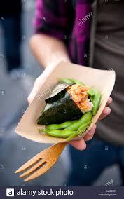 A Man Holds Sushi And Edamame At The Off The Grid Food Truck Round ... Off The Grid Fort Mason Food Trucks Favorite Places To Eat Truck Friday Rentnsellbdcom Mobile News The Kicks Off Eighth Season At With New Look San Francisco New Season Delights Frenzy Urban Hypsteria My Bucket List Food Organization Wikipedia California Stock Photos Burlingame Kim Chronicles Fleet Heads Santa Rosa And Carts You Cant Miss On Your Next Trip Grids Creator Looks Beyond These