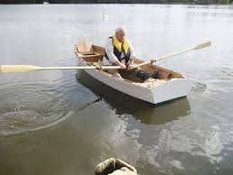 norman fuller launches his ella plywood skiff built to free plans