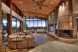Luxury Rustic Living Room With Brown Leather Furniture And Curved Ceiling Custom Copper Fireplace
