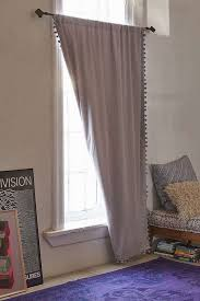 Plum And Bow Blackout Pom Pom Curtains by 15 Items To Cozy Up Your Living Room Brit Co