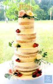 Semi Naked Wedding Cake Decorated With Fresh Flowers By Bath Company Set Up At
