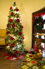 Christmas Tree Decorated With Knitted Red Poinsettia Flowers