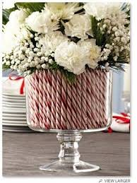 Candy Cane Flower Vase Makes A Cute Centerpiece For Christmas Dinner And Tons Of Other Easy DIY Holiday Decorations
