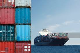 Shipping Containers And Ship Stock Photo