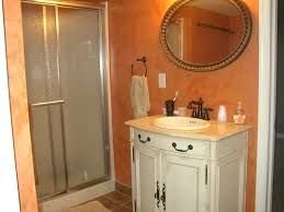 Small Basement Bathroom Designs by Step Down Glass Block Wall Counter With Copper Vessel Sink