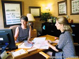 Nancy Cutter A Travel Agent In Charlotte North Carolina Discusses Vacation Options With