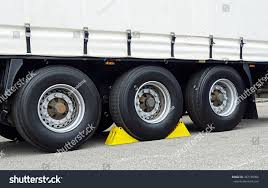 Yellow Chocks Wheel Trucktrailer Stock Photo 387148906 - Shutterstock Goodyear Wheel Chocks Twosided Rubber Discount Ramps Adjustable Motorcycle Chock 17 21 Tires Bike Stand Resin Car And Truck By Blackgray Secure Motorcycle Superior Heavy Duty Black Safety Chocktrailer Checkers Aviation With 18 In Rope For Small Camco Manufacturing Truck Bed Wheel Chock Mount Pair Buy Online Today Titan Wheels Gallery Pinterest Laminated 8 X 712