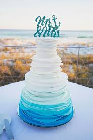 Picture Of Ruffle Ombre Wedding Cake In Shades Blue And A Sparkling Topper