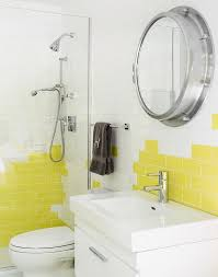 white and yellow kids bathroom with yellow subway tiles