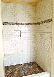 white floor to ceiling subway tile with silverado gray grout and