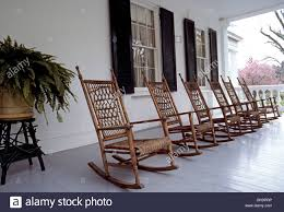 Rocking Chairs Made Of Wood And Wicker Await Visitors On The Front ... Rocking Chairs Made Of Wood And Wicker Await Visitors On The Front Tortuga Outdoor Portside Plantation Chair Dark Roast Wicker With Tan Cushion R199sa In By Polywood Furnishings Batesville Ar Sand Mid Century 1970s Rattan Style Armchair Slim Lounge White Gloster Kingston Chair Porch Stock Photo Image Planks North 301432 Cayman Islands Swivel Padmas Metropolitandecor An Antebellum Southern Plantation Guildford